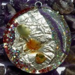 Orgone pendant front side with silver, aventurine,carneol,unakite and red, violet sparkles