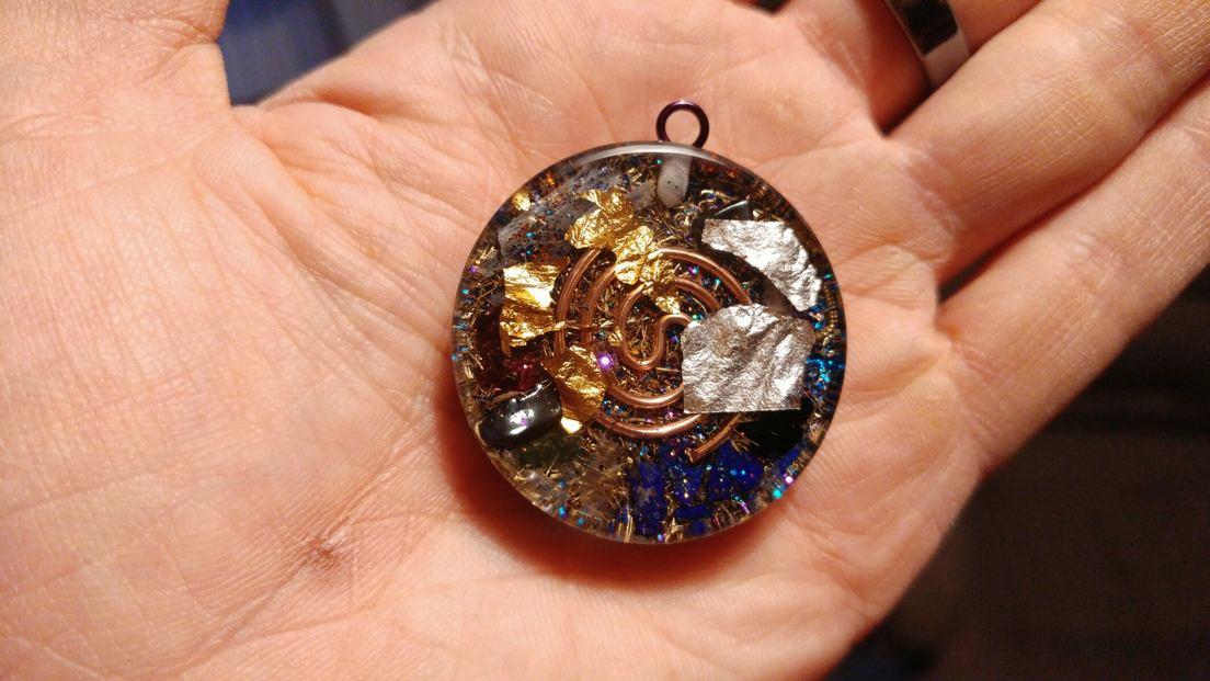 Om orgone pendant orgone pendants by cosmic energy orgone pendant mozeypictures Choice Image